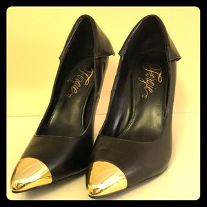Black heels with gold tip